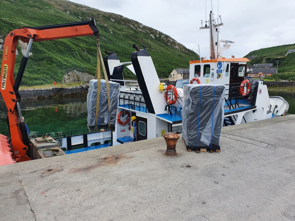 Pallets of Irish Coastal Gin being loaded on Cape Clear Island for Free Distribution Spirits, France.